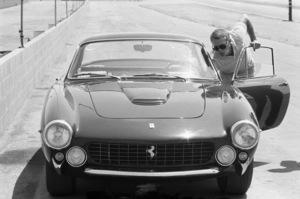 Steve McQueen reaching into his 1963 Ferrari 250 GT Lusso Berlinetta at the Riverside Raceway in Riverside, CA 1966 © 1978 Chester Maydole - Image 0019_0877