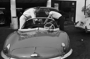 Steve McQueen with his 1957 XK-SS Jaguar at Grand Prix Sportscar Center on Melrose Avenue in Los Angeles, CA 1960 © 1978 Sid Avery - Image 0019_0920