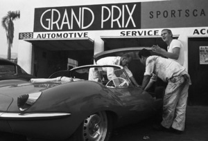 Steve McQueen talking to his 1957 XK-SS Jaguar mechanic at Grand Prix Motors on Melrose Avenue in Los Angeles1960© 1978 Sid Avery - Image 0019_0921