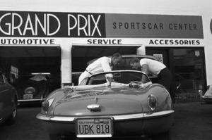 Steve McQueen talking to his 1957 XK-SS Jaguar mechanic at Grand Prix Motors on Melrose Avenue in Los Angeles1960© 1978 Sid Avery - Image 0019_0922