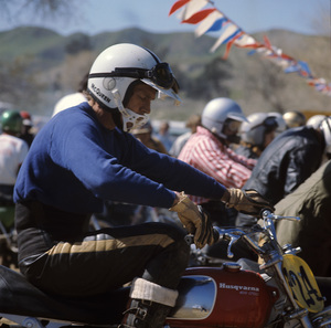 Steve McQueen racing on his Husqvarna motorcycle at Indian Dunes circa 1970s © 1978 Chester Maydole - Image 0019_1089