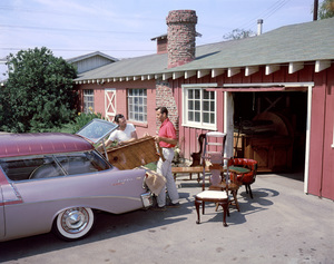 George Montgomery, right, helps load furniture into a 1956 Chevrolet Bel Air Nomad Cotillion, with Al Messenger, the finisher at his custom furniture and woodworking business in Van Nuys, CA1957 © 1978 Sid Avery - Image 0020_0110