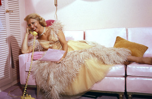 Dinah Shore rmakes a phone call as she relaxes in her dressing room at NBC TV Studio prior to showtimeMay 16, 1957 © 1978 Sid Avery - Image 0020_0111