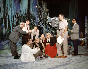 Dinah Shore at NBC Studios: Standing L to R: Harry Zimmerman, musical director of Dinah