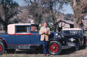 Jack Palance with a 1929  Cadilllac Coupe, & a 1942 Lincoln Continental Cabrioletin the background. 1982.**H.L. - Image 0021_0443