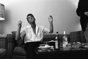 """Dean Martin in his dressing room, """"ostentatiously avoiding temptation,"""" in Hollywood1961© 1986 Sid Avery - Image 0022_0003"""