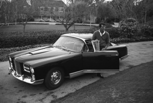 Dean Martin and his Facel Vega HK500 in the driveway of his Beverly Hills home on Mountain Drive1961© 1978 Sid Avery - Image 0022_0110