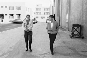 Dean Martin walking with his assistant, Mack Gray1961 © 1978 Sid Avery - Image 0022_1459