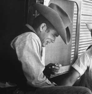"""James Dean on location for """"Giant"""" in Marfa, Texas, 1955. © 1978 Sid Avery - Image 0024_0061"""