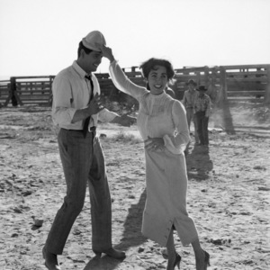 "Elizabeth Taylor and Rock Hudson on the set of ""Giant"" in Marfa, Texas 1955 © 1978 Sid Avery - Image 0024_0073"