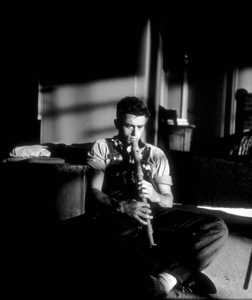 """James Dean plays a baritone recordergiven to him by a fan while on locationfor """"East of Eden.""""1955 Warner / MPTVPhoto by Jack Albin - Image 0024_0255"""