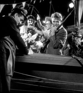 "James Dean preparing for carnival shootingrange scene in ""East of Eden.""1955 Warner / MPTVPhoto by Floyd McCarty - Image 0024_0333"