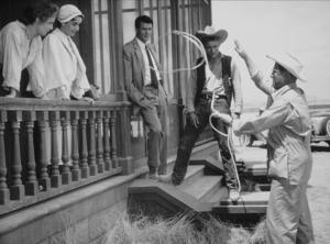 "Elizabeth Taylor, Rock Hudson and James Dean in ""Giant"" Director George Stevens.1955 Warner Bros. © 1978 Floyd McCartyMPTV - Image 0024_0404"