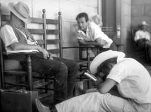 James Dean taking a picture with Sid Avery