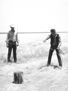 """James Dean practices roping with Bob Hinkleon location for """"Giant"""" in Marfa, Texas.1955 Warner / MPTVPhoto by Floyd McCarty - Image 0024_0443"""