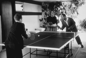 Virtuoso violin player, Jascha Heifetz, with his wife, Frances, and son, Jay, playing ping-pong at their Beverly Hills, CA, home, 1953. © 1978 Sid Avery MPTV - Image 0030_0003