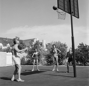 Sammy Cahn playing basketball with his wife Gloria and children, Stephen and Lori1959 © 1978 Sid Avery - Image 0031_0102