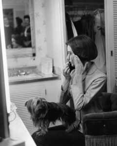 Audrey Hepburn in her Paramount studio dressing room with her pet dog, Famous1957 © 1978 Sid Avery - Image 0033_0002