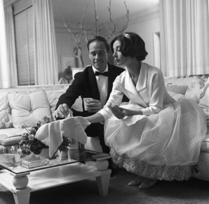 Audrey Hepburn and Mel Ferrer at their Los Angeles home having some milk1957© 1978 Sid Avery - Image 0033_0103