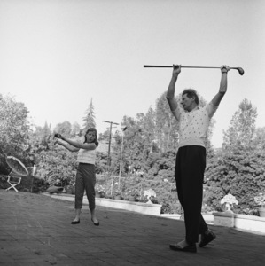 Danny Kaye stretching with his daughter Dena  1958 © 1978 Sid Avery - Image 0035_0526