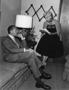 Kim Novak going over a script with an unidentified friend at her home in Los Angeles1956© 1978 Sid Avery - Image 0036_0010