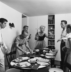 Kim Novak having a dinner party at home with Nick Adams1956© 1978 Sid Avery - Image 0036_0026