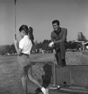 James Garner golfing with his step-daughter Kimberly circa 1958 © 1978 David Sutton - Image 0037_0810