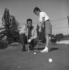 James Garner golfing with his step-daughter Kimberly circa 1958 © 1978 David Sutton - Image 0037_0817