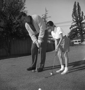 James Garner golfing with his step-daughter Kimberly circa 1958 © 1978 David Sutton - Image 0037_0818