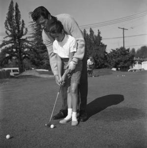 James Garner golfing with his step-daughter Kimberly circa 1958 © 1978 David Sutton - Image 0037_0819