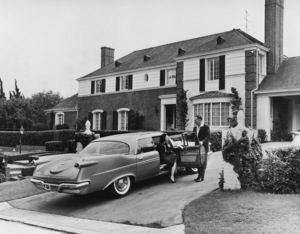 Art Linkletter and his wife Lois at their home on Mapleton Drive in Holmby Hills, California with their Dodge1945 - Image 0046_1092