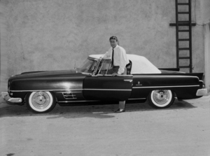 """PETER LAWFORD ON THE SET OF """"THE THIN MAN"""" WITH HIS 1957 DUAL GHIA / 1957 NBC.PHOTO BY GERALD SMITH - Image 00543_0044"""