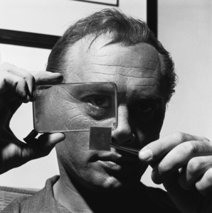 Yul Brynner inspecting his stamp collection1958© 1978 Sid Avery - Image 0056_0001