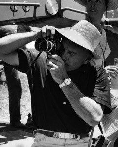 """Yul Brynner taking a photo during the filming of """"Taras Bulba""""1961 © 1978 Marv Newton - Image 0056_1032"""