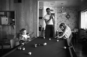 Don Drysdale takes a break to play a relaxing game of billiards in their Los Angeles home with wife Eula Ginger Dubberly and their child1961 © 1978 Sid Avery - Image 0058_0303