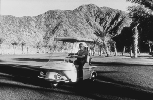 Dwight D. Eisenhower riding in a golf cart in Palm Springs, CA, 1961. © 1978 Sid Avery MPTV - Image 0060_0020