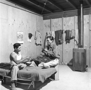 """Mexican Braceros (""""Helping Hands from Mexico"""" - The Saturday Evening Post - August 10, 1957 - volume 230, number 6)Caption: """"Shelter and bed are provided free, but Rafael (left) must pay for his food.""""1957© 1978 Sid Avery - Image 0063_0027"""
