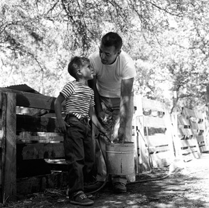 Tennessee Ernie Ford on his ranch in Clear Lake, California with son Jeffery1957 © 1978 Sid Avery - Image 0064_0014