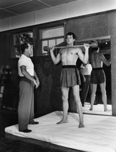 Rock Hudson with his trainer at the studio gym1952© 1978 Sid Avery - Image 0067_0003