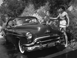 Rock Hudson washing his 1952 Oldsmobile outside of his North Hollywood home1952 © 1978 Sid Avery - Image 0067_0017