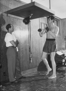 Rock Hudson boxing, at home in North Hollywood, CA, 1952. © 1978 Sid Avery MPTV - Image 0067_0018