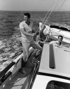 "Rock Hudson on his sailboat ""Khairusam"" with Gia Scala and Don Barnett 1959 © 1978 Gene Trindl - Image 0067_1040"