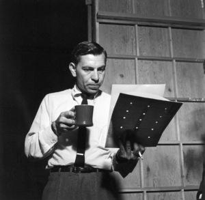 "Jack Webb Reading script on set, 1953. ""Dragnet"" © 1978 Sid Avery 0068-1012 - Image 0068_1012"