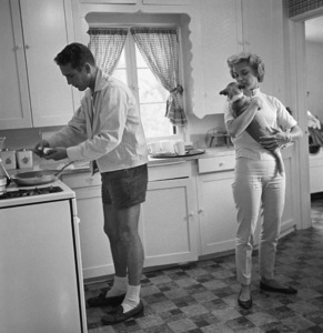 Paul Newman and Joanne Woodward in the kitchen of their Beverly Hills home1958© 1978 Sid Avery - Image 0070_0002