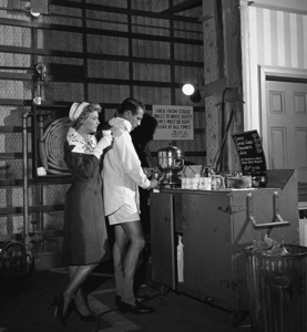 """Paul Newman and Joanne Woodward during a break in filming """"Rally"""