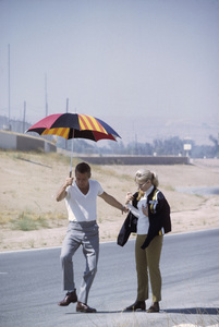 """Paul Newman with wife Joanne Woodward on loaction at Riverside Raceway in California for the filming of """"Winning""""1968© 1978 David Sutton - Image 0070_2005"""