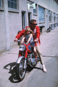 "Paul Newman with daughterMelissa, on location at IndianapolisMotor Speedway for ""Winning,"" 1968. © 1978 David Sutton - Image 0070_2019"
