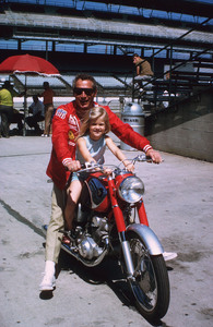 """Paul Newman with daughterMelissa, on location at IndianapolisMotor Speedway for """"Winning,"""" 1968. © 1978 David Sutton - Image 0070_2020"""