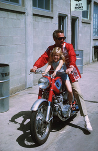 "Paul Newman with daughterMelissa, on location at IndianapolisMotor Speedway for ""Winning,"" 1968. © 1978 David Sutton - Image 0070_2021"