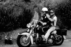 Paul Newman gets a ridewith a motorcycle cop, 1965. © 1978 David Sutton - Image 0070_2322